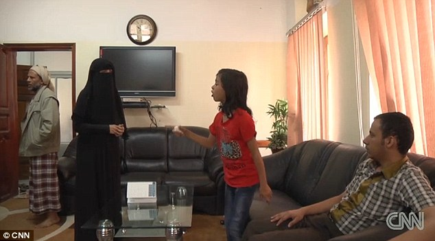 Family: A crunch meeting saw Nada (centre) face her parents (left) on camera with her uncle (right). An agreement was fixed that means Nada, her parents and uncle are going to move in together