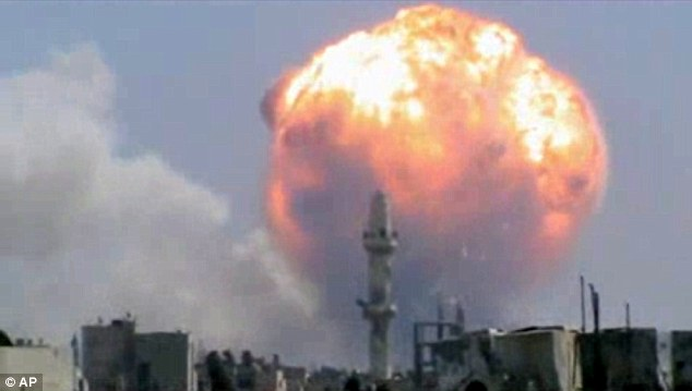 Blast: An enormous fireball rises into the sky after a rebel rocket hit a government arms depot in the central Syrian city of Homs