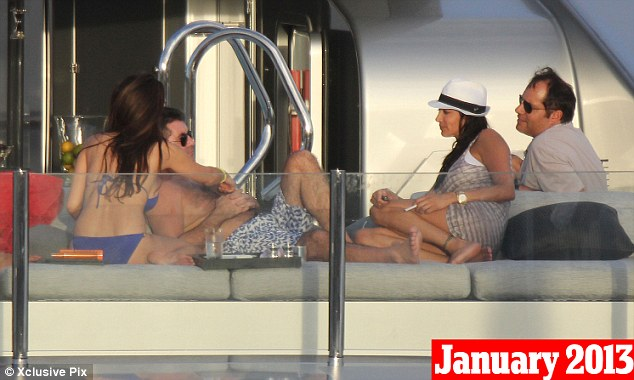 January 4th, 2013: Cowell and Mezhgan (blue bikini) are seen on holiday in St Barts with Lauren and Andrew