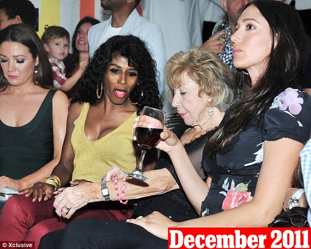 December 29th, 2011: Lauren was seen sitting next to Cowell's mother Julie and Sinitta