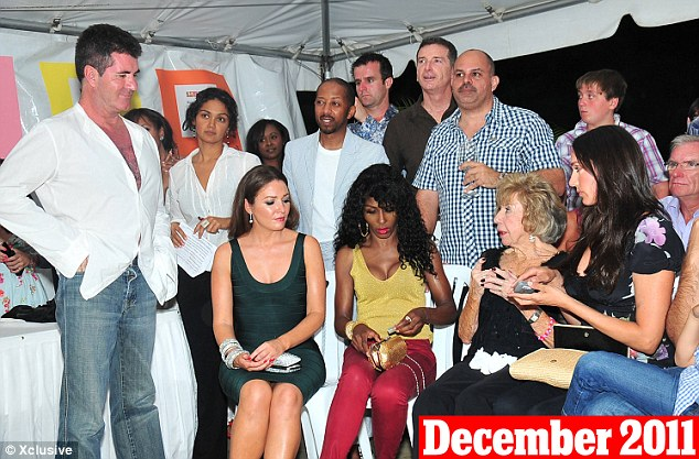 December 29th, 2011: Cowell and Lauren (far right) are seen attending the Hope-Martin Foundation Charity Auction in Barbados together