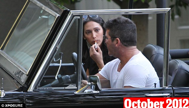 October 28th, 2012: Lauren and Cowell were both seen puffing on cigarettes during the house hunting excursion