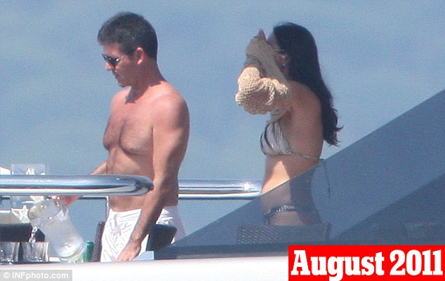 August 4th, 2011: Lauren covered up in a beach cover-up as Cowell poured her a drink on deck