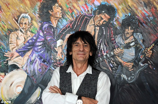 Talent: Ronnie Wood (in front of a previous painting he put on display) took formal training at Ealing College of Art in London
