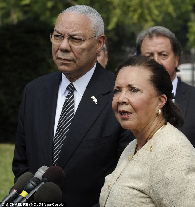 Colin Powell and his wife Alma Powell deliver remarks following a meeting with business leaders and Obama administration officials on ways to improve education in July 2011