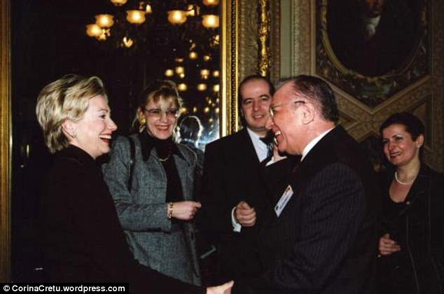 Cretu posted this photo to her blog with the caption 'Congress, meeting Mr Chairman with Mrs. Clinton, 1998.' Hillary Clinton is pictured far left and Cretu is second-from-left