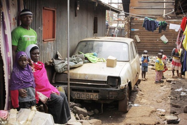Struggle: The victim's pregnant wife says she cannot afford her rent in this Nairobi slum because the family survived on her husband's wages