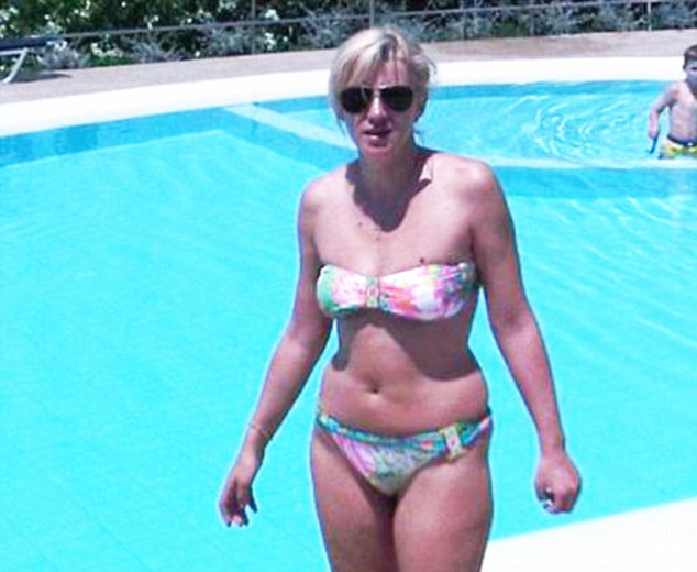 Corina Cretu emailed Colin Powell this photo of herself at a pool