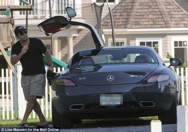 Coming home: Andrew Silverman spotted arriving back at his house in Bridgehampton, New York Friday