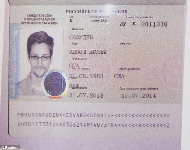 It's official: Edward Snowden's new refugee documents granted by Russia is seen during a Thursday news conference in Moscow