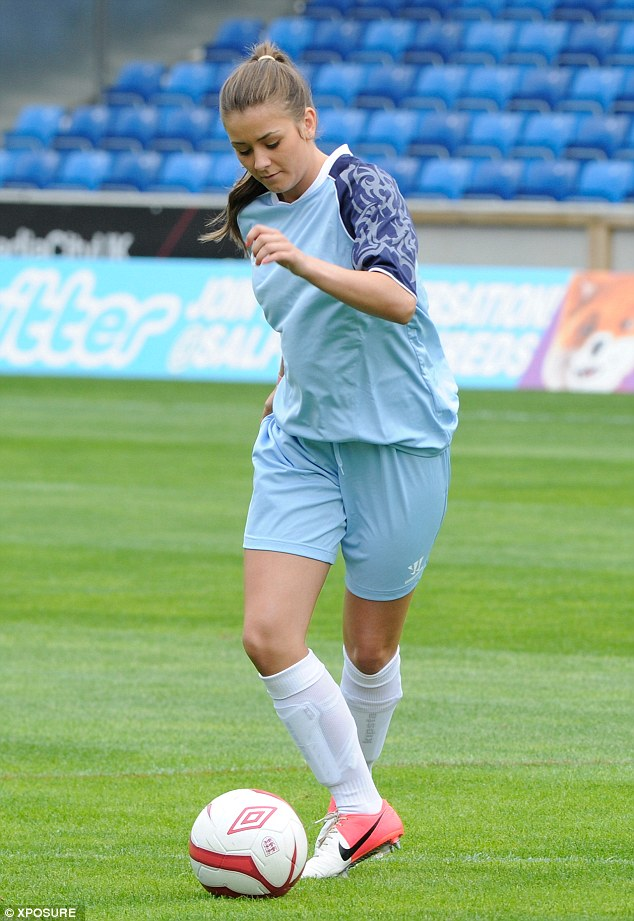 Brooke Vincent shows off her skills as she warms up on Sunday during the One Goal Foundation Charity football match in Salford, Manchester