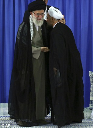President-elect Hasan Rouhani, right, kisses the robe of Supreme Leader Ayatollah Ali Khamenei, after receiving his official seal of approval