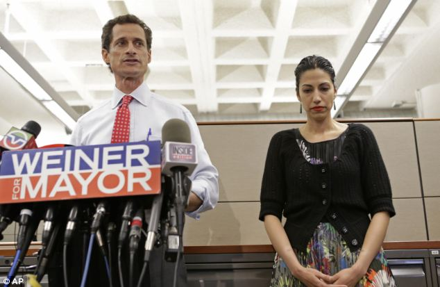 Headlines: The second-most targeted politician after Obama was New York mayoral candidate Anthony Weiner, (pictured with his wife Huma) who has been involved in sexting scandals