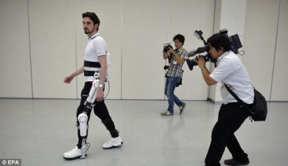 A Cyberdyne employee demonstrates the medical Robot Suit HAL during a press event at the company headquarters in Tsukuba, north-east of Tokyo after the suit received an EC certificate from German safety monitoring agency TUV Rhineland