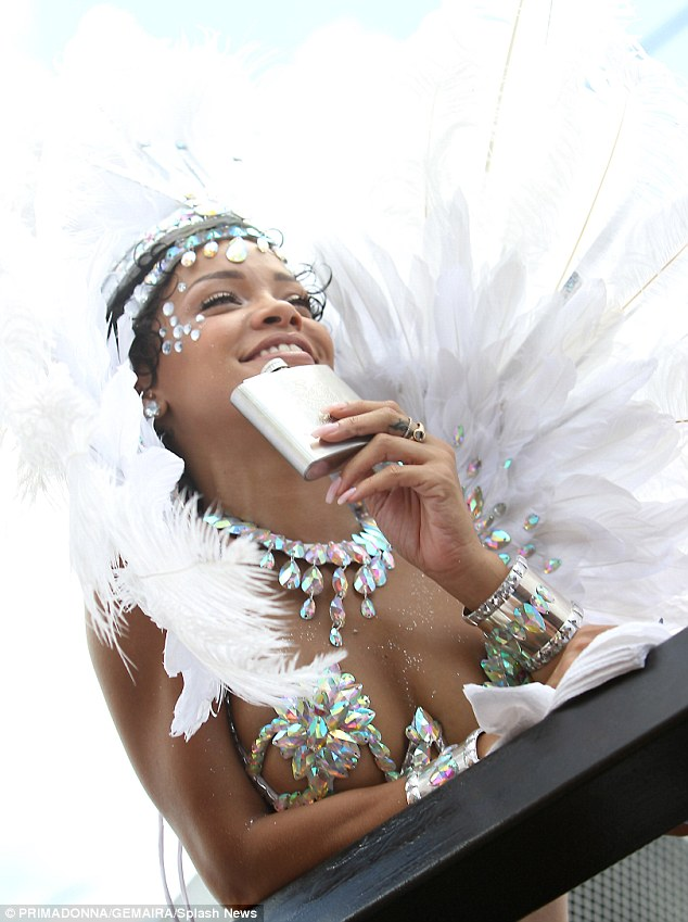 Having a ball: The 25-year-old was seen sipping out a hip flask as she danced on a float