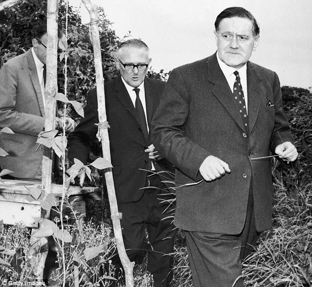 Closing in: Detective Superintendent Gerald McArthur is pictured searching for clues in the grounds of the suspects' hideout