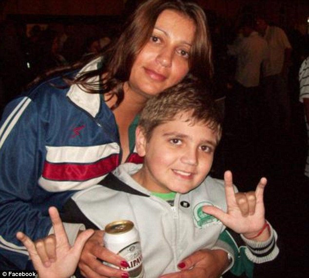 Marcelo Pesseghini poses for a photo with his mother Andreia Pesseghini who was found dead on her knees. The youngster was found dead from a gunshot to the left temple and his father's police-issue service revolver was found nearby
