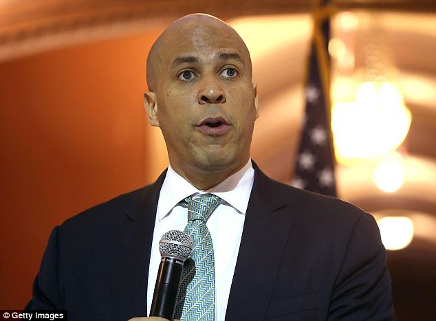Public face: Cory Booker, the current mayor of Newark, New Jersey who is now running for Senate, is the founder of a video aggregation start up and he stands to make $1million to $5million out of the company