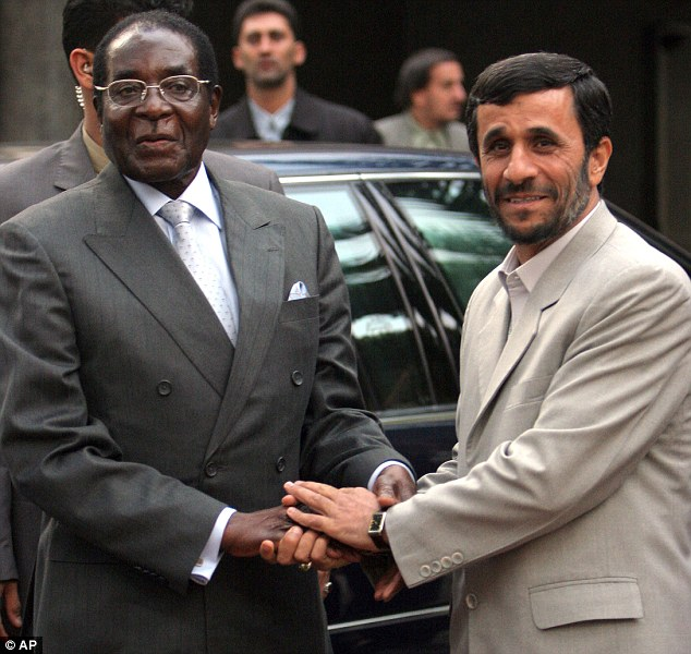 Concerns: Zimbabwean president Robert Mugabe, seen here shaking hands with former Iranian President Mahmoud Ahmadinejad in 2006, is believed to have signed a secret deal to supply uranium to Tehran