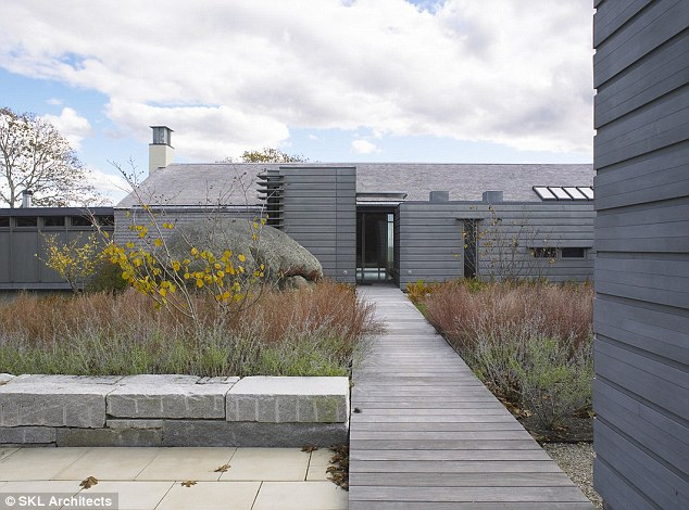 Natural: A boulder left by a glacier in the Ice Age is next to the entrance of the Rick Sundberg-designed house