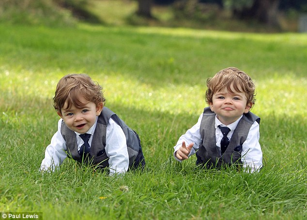 Cheeky: Twins Cole (left) and Logan (right) Weston who play baby George in Downton Abbey come from the village of Meathop in Cumbria and began filming when they were just six months old