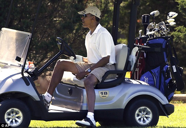 President Barack Obama steers his cart while golfing at Farm Neck Golf Club. He will be in Martha's Vineyard for eight days