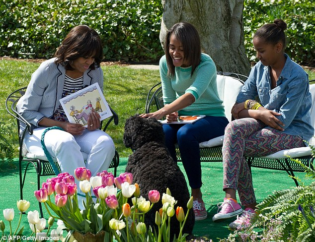 Faithful hound: The Obama girls Sasha and Malia (seen here with Bo in April) will be pleased their dog has come to join them on holiday in Martha's Vineyard