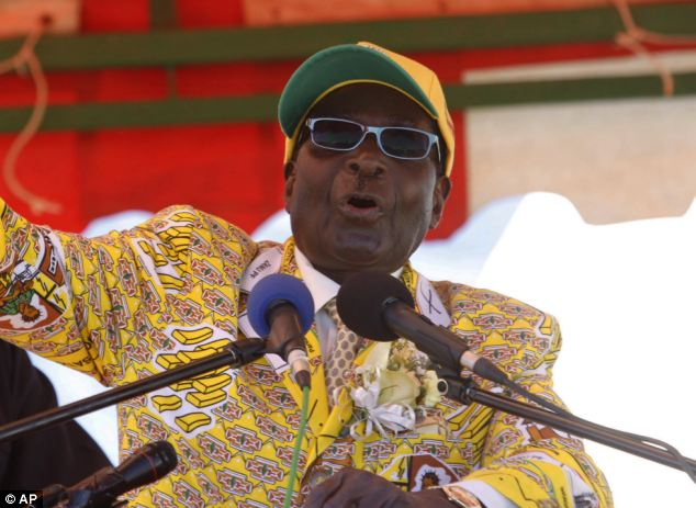 Victory: Robert Mugabe quashed claims that the election was a fraud. He described outgoing Prime Minister Morgan Tsvangirai as the 'enemy' and said: 'You are never going to rise again'