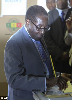 New leader: Zimbabwean President Robert Mugabe casting his vote in July's elections. He said: 'Never will we go back on our victory'