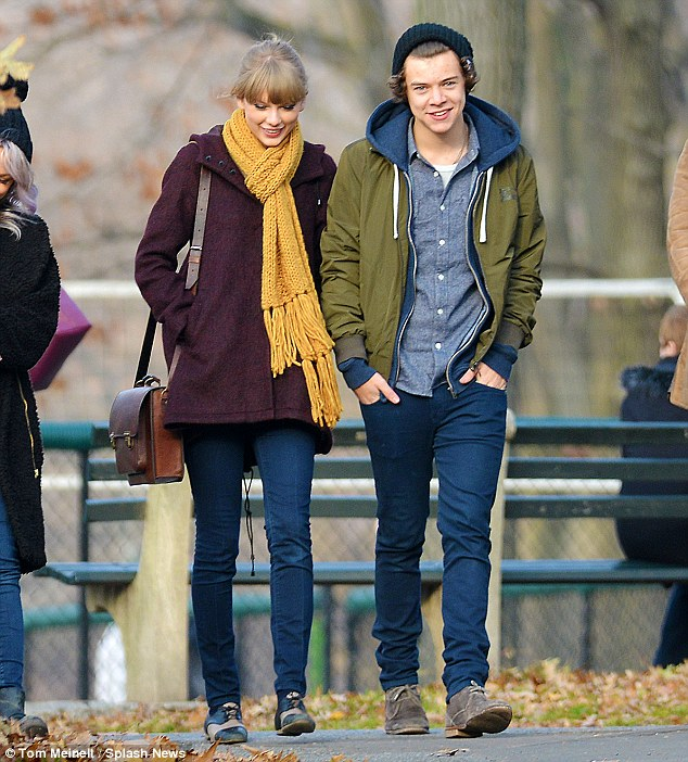 Swift removal: Taylor and One Direction's Harry Styles, pictured here on a happier day in December, had a brief fling late last year