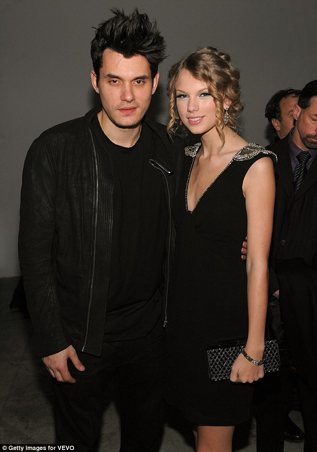 Cosy: Taylor cuddled up to her once rumoured beau John Mayer at the VEVO launch in 2009