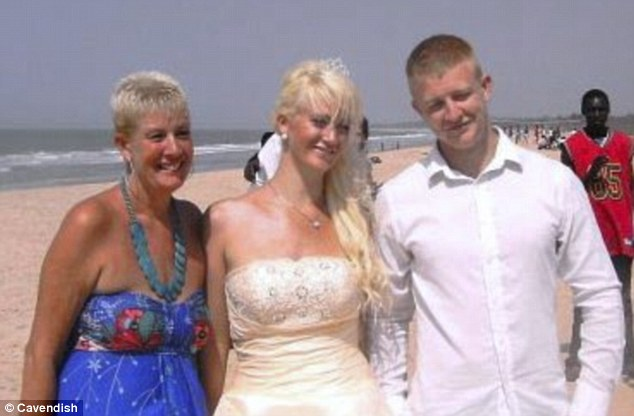 Dream wedding: Simone pictured at her beach wedding on Valentine's day in 2010 with her mother Janice and Peter in Banjul, Gambia