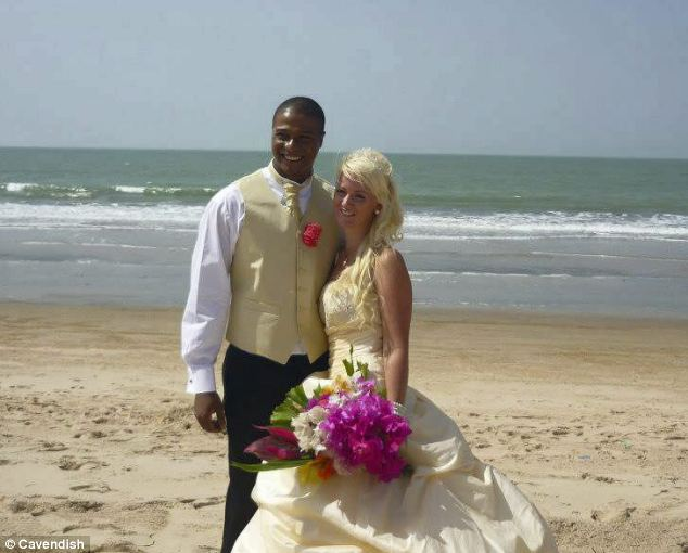 Happier times: Simone and her husband who was known as Carlos pictured on their wedding day in a Gambian beach ceremony