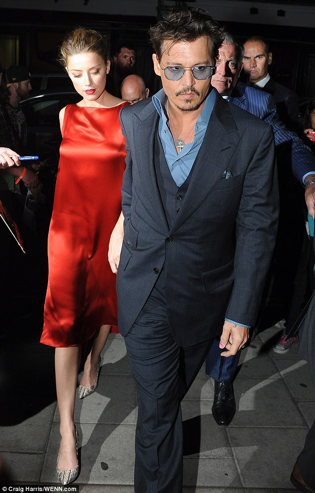New romance: Amber is dating her Rum Diary costar Johnny Depp, 50, pictured together in July in London