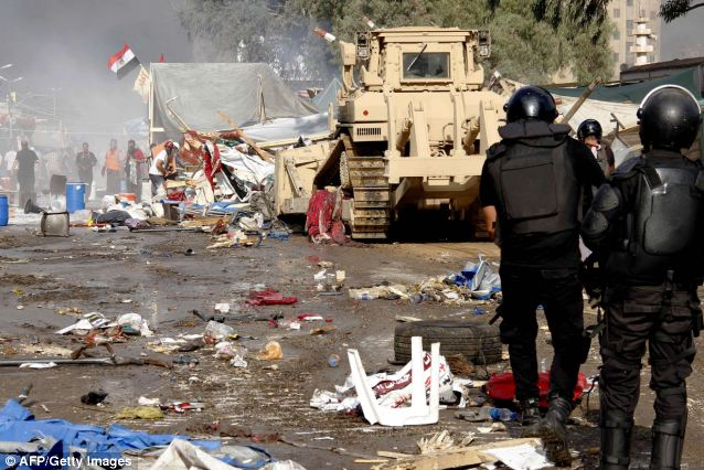 Force: Bulldozers moved in this morning to clear the camp