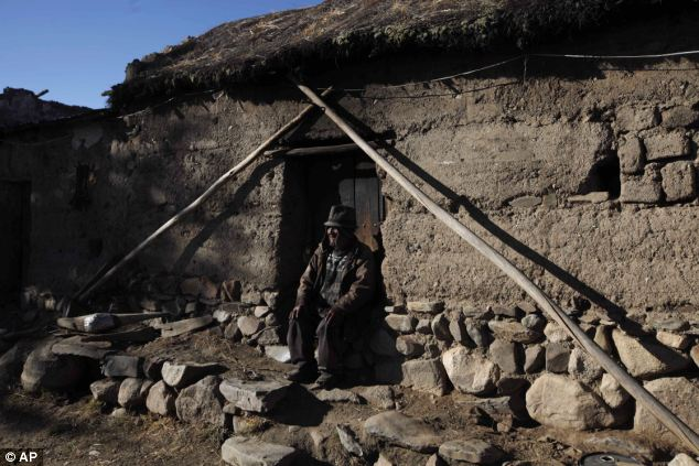 Home: Carmelo Flores Laura sits outside his home in the village of Frasquia, Bolivia