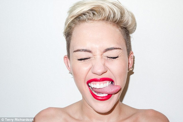 Pearly whites: Miley has undergone a drastic change of image in the past year, cutting her hair and striking plenty of provocative poses