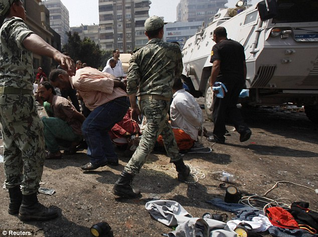 Soldiers: Suspects are rounded up near an annex building of Rabaa Adawiya mosque after the clearing of a protest camp around the mosque in Cairo