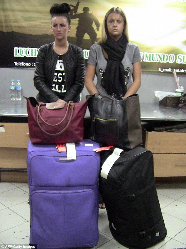 Game's up: Michaella McCollum Connolly and Melissa Reid at the moment of their arrest at Lima's international airport on suspicion of trying to smuggle 11 kilos of cocaine out of the country
