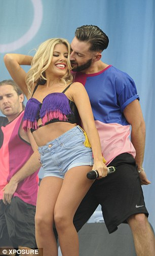 Mollie King gyrates with a dancer during the Saturdays' performance at Virgin Media's V Festival this weekend