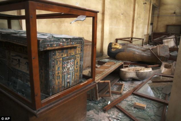 Break in: Damaged objects lie on the floor and in broken cases in the Malawi Antiquities Museum after it was ransacked and looted