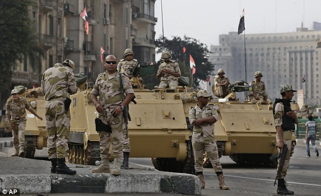 Chaos: The violence in Egypt continued today as 24 policemen were killed in Sinai