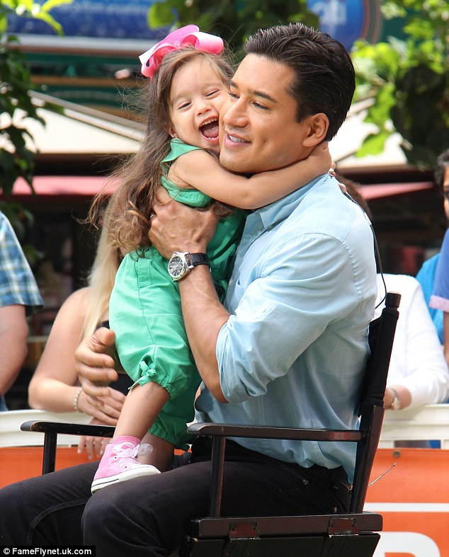 Quality time: Gia was clearly very happy to see him, as she flung her arms around her dad and gave him her full attention