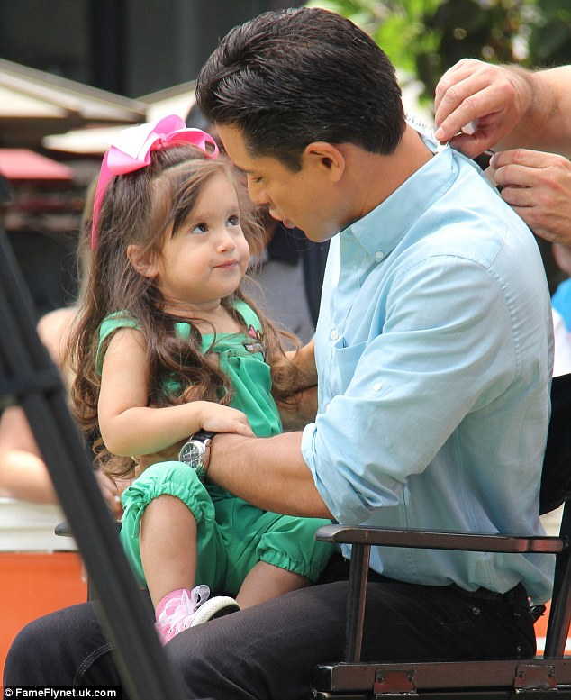 Quality Time: Gia was clearly very happy to see him, as she flung her arms around her dad (left) and gave him her full attention (right)