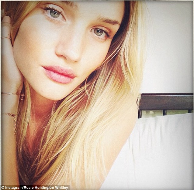 Rosie Huntington-Whiteley demonstrates the typical slap-free selfie, complete with doe eyes and soft lighting