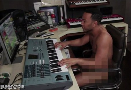 In the studio: Clothes appear to give Legend a creative block, so he strips down and immediately has an easier time working on his tracks