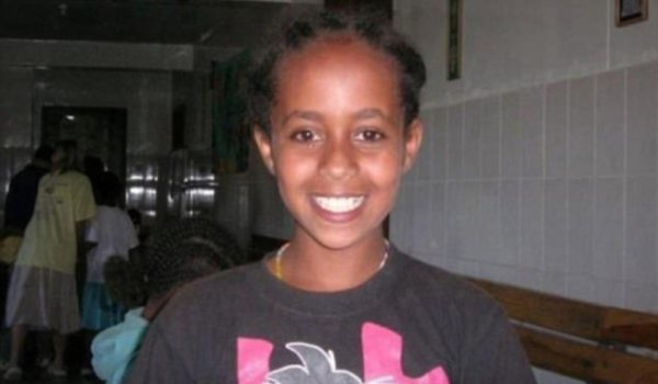 Happier times: Hana Williams, seen in this undated photo looking healthy, was found frozen and starved to death in the yard of her adoptive parents' home in 2011