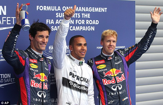 The three amigos: Red Bull's Mark Webber (left) and Sebastian Vettel flank pole-sitter Hamilton