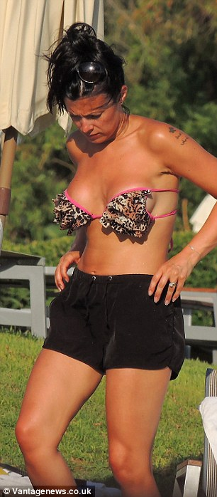Wild side: The soap star later changed into a leopard print bikini as she lounged around by the pool