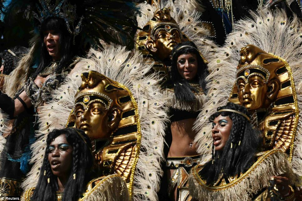 Performers participate in the Notting Hill Carnival in west London